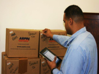 Arpin agent inspecting boxes