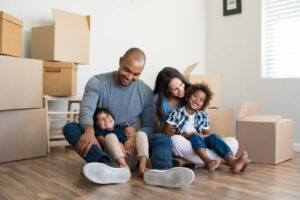 Family getting ready to move into a new home