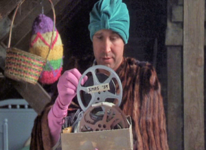 Clark Griswold in his attic reminiscing as he looks through old boxes of memorabilia
