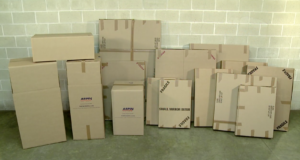 An array of perfectly labeled Arpin of RI wardrobes, dish barrels, and mirror boxes in a warehouse