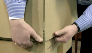 Close up of the flap tabs of a professional Arpin of RI moving carton getting released