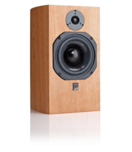 a large speaker with the fabric front removed exposing the delicate speaker components.