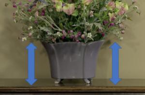 delicate flower arrangement with ceramic base