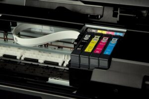 C406 Image of the interior of a printer showing the different ink reservoirs.