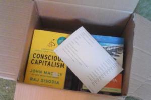 Image of a half-full carton of books demonstrating the horizontal layering method