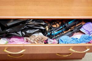 an open dresser drawer showing clothing inside.