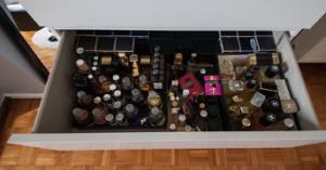 an open dresser drawer showing prohibited liquids inside
