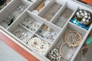 an open dresser drawer showing jewelry inside