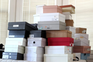 boxes of shoes stacked on the floor.