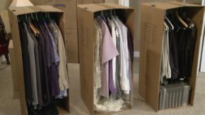 a long individual garment bag pooling at the bottom of a wardrobe.