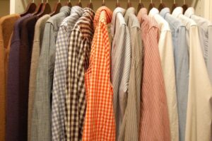 tightly spaced clothes on hangers