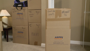 C485 Image of a fully packed and labeled Arpin of RI wardrobe.