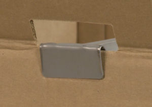 Close up image of the wardrobe bar position on the top of the carton.