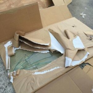 A broken glass table top as it is being unpacked after a move