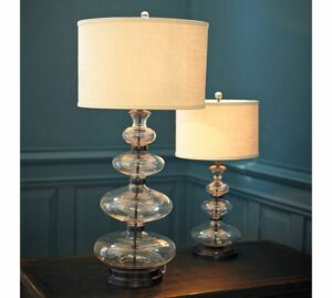 A glass and metal table lamp