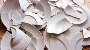 Many broken white china dishes